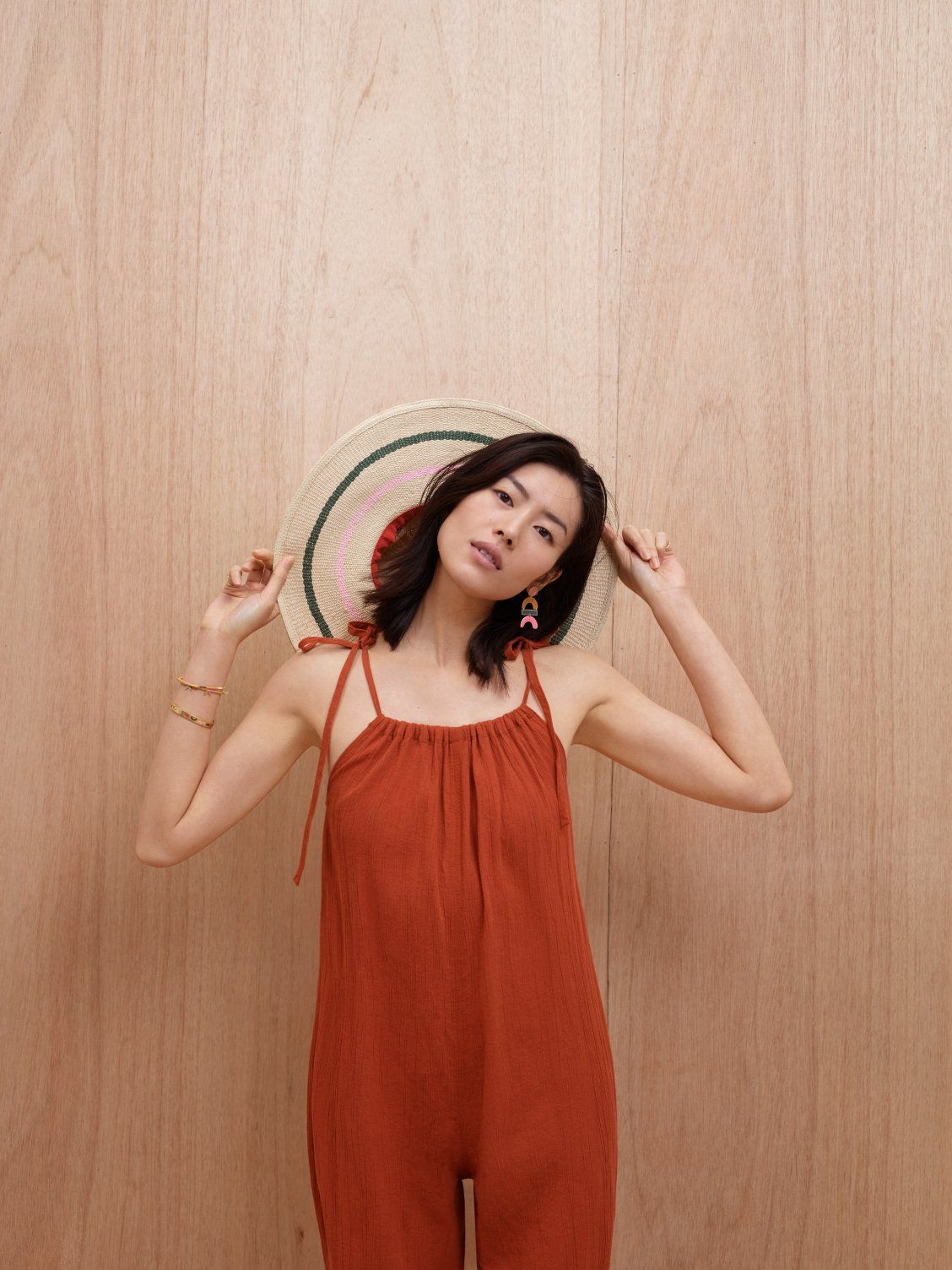 8458ec66 madewell x biltmore® tulum striped straw hat worn with gauze tie-strap  jumpsuit, newform statement earrings + enamel glider bangle bracelet.