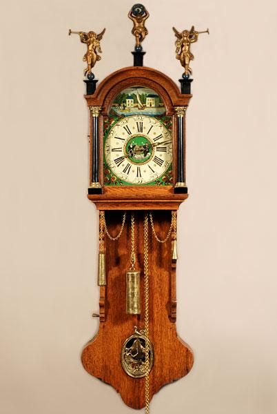 A Small And Attractive Dutch Frisian Stained Wall Clock