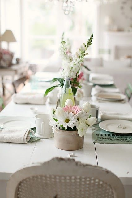 white table and settings with light color accents and French ...