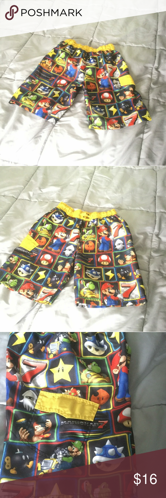543d28392f Nintendo's Mario Bros Kart 7 boy swimming shorts Kids size 10 100%  Polyester Front drawstring missing, and a small whole behind where the  front drawstring ...