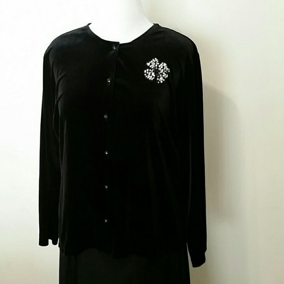 Black velvety cardigan It's poly/spandex for easy care, but it feels like velvet. Black faceted buttons. Sequin flower accent. Perfect condition. Notations Sweaters Cardigans