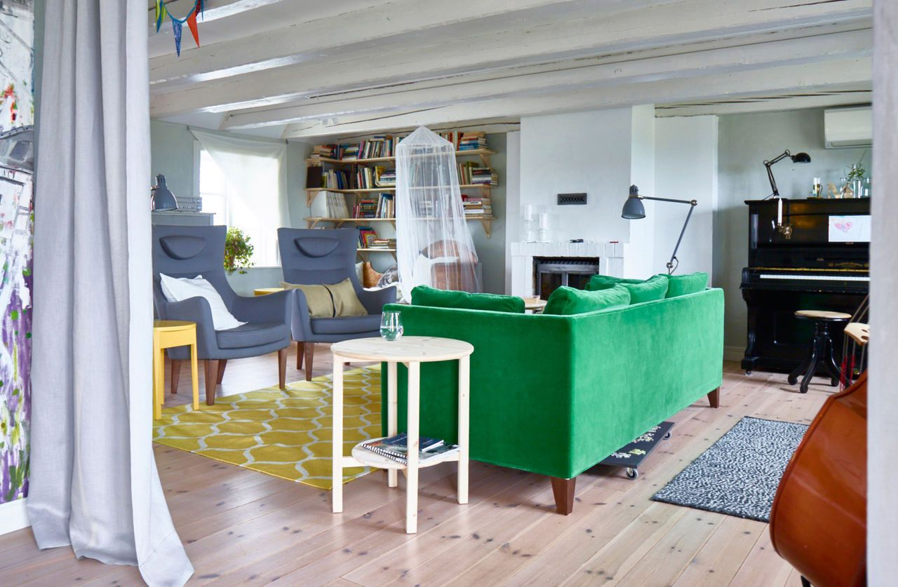 With the colourful green sofa, the two grey armchairs and antique ...