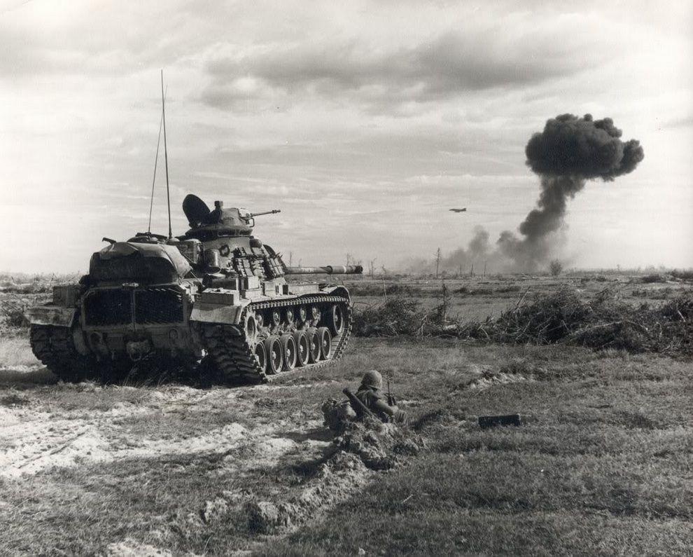 Heavy armor provides support as f 4 phantom fighter bomber makes a bomb run south vietnamvietnam warvietnam