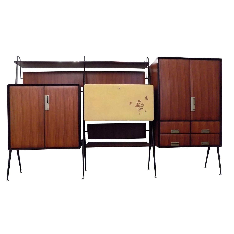 1950 SILVIO CAVATORTA Parete attrezzata in palissandro e metallo verniciato, interni in acero ...