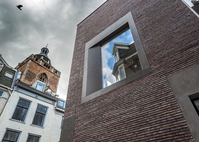 modern brick apartment building. Dreessen Willemse adds modern brick building to old Utrecht street