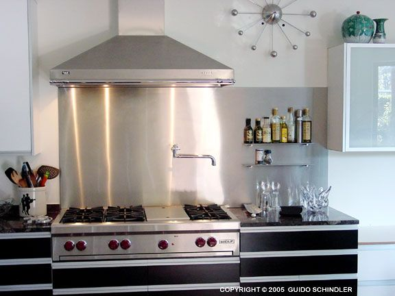 behind stove stainless steel backsplashes room by room the kitchen backsplash nest - Stainless Steel Kitchen Backsplash Ideas