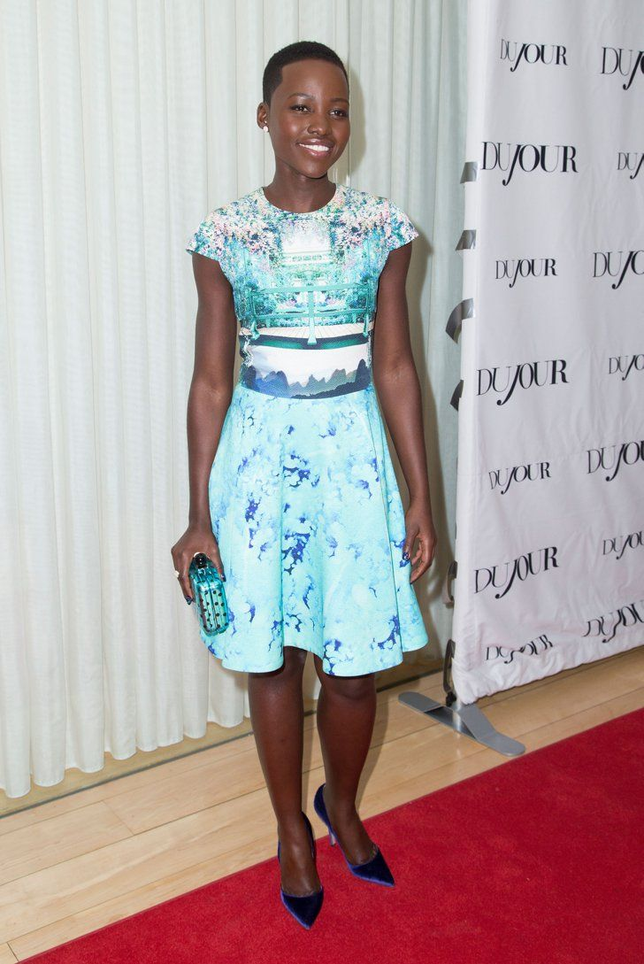 Pin for Later: Lupita Is Not Only People's Most Beautiful, She's Also America's Most Stylish Lupita Nyong'o at the DuJour Party It was a bold Mary Katrantzou Resort 2014 print for Lupita at a DuJour magazine party before the Golden Globes.