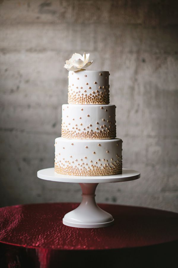 wedding cake with dots gold dot cake photo by julie wilhite wedding 26869
