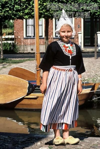 girl in a traditional dutch costume at the zuider zee museum in enkhuizen , the netherlands stock photo