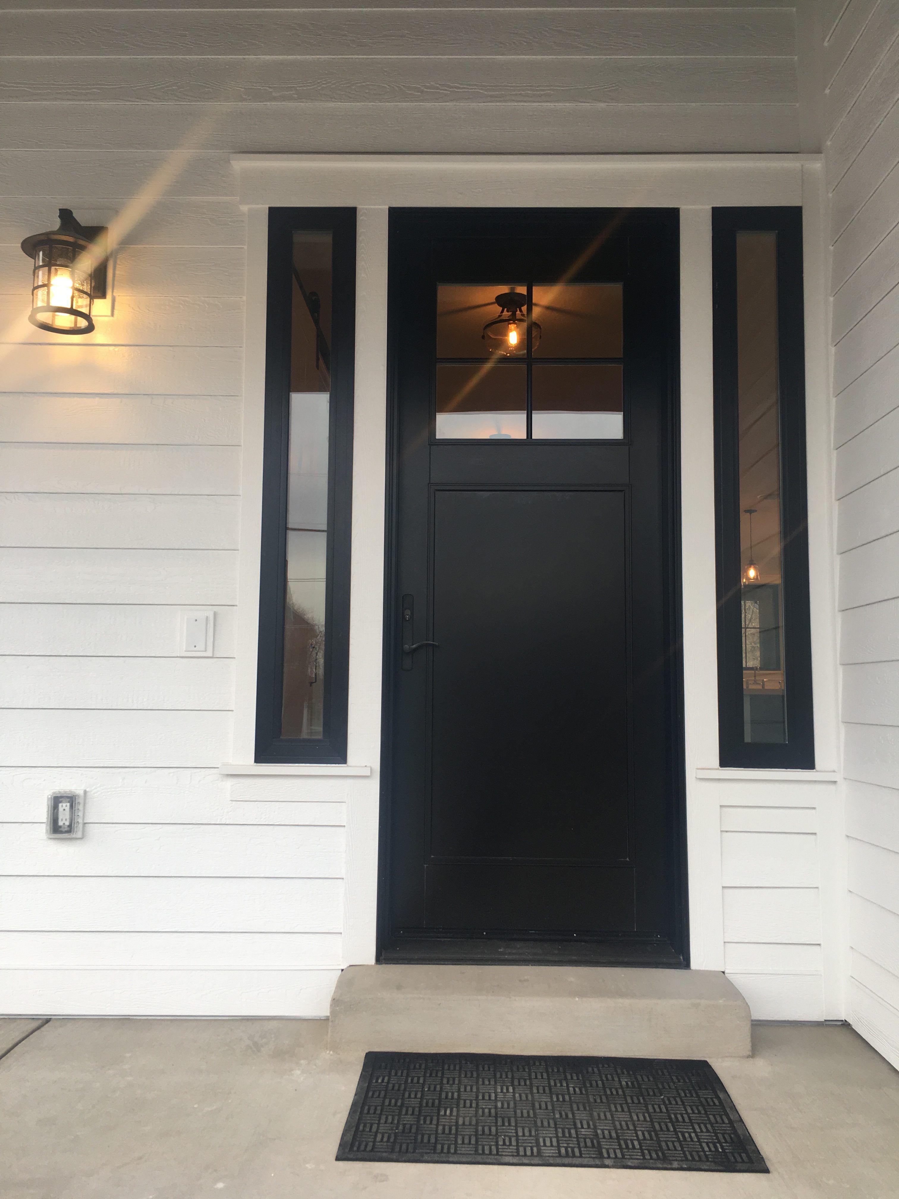 Black farmhouse front door grant norris building company