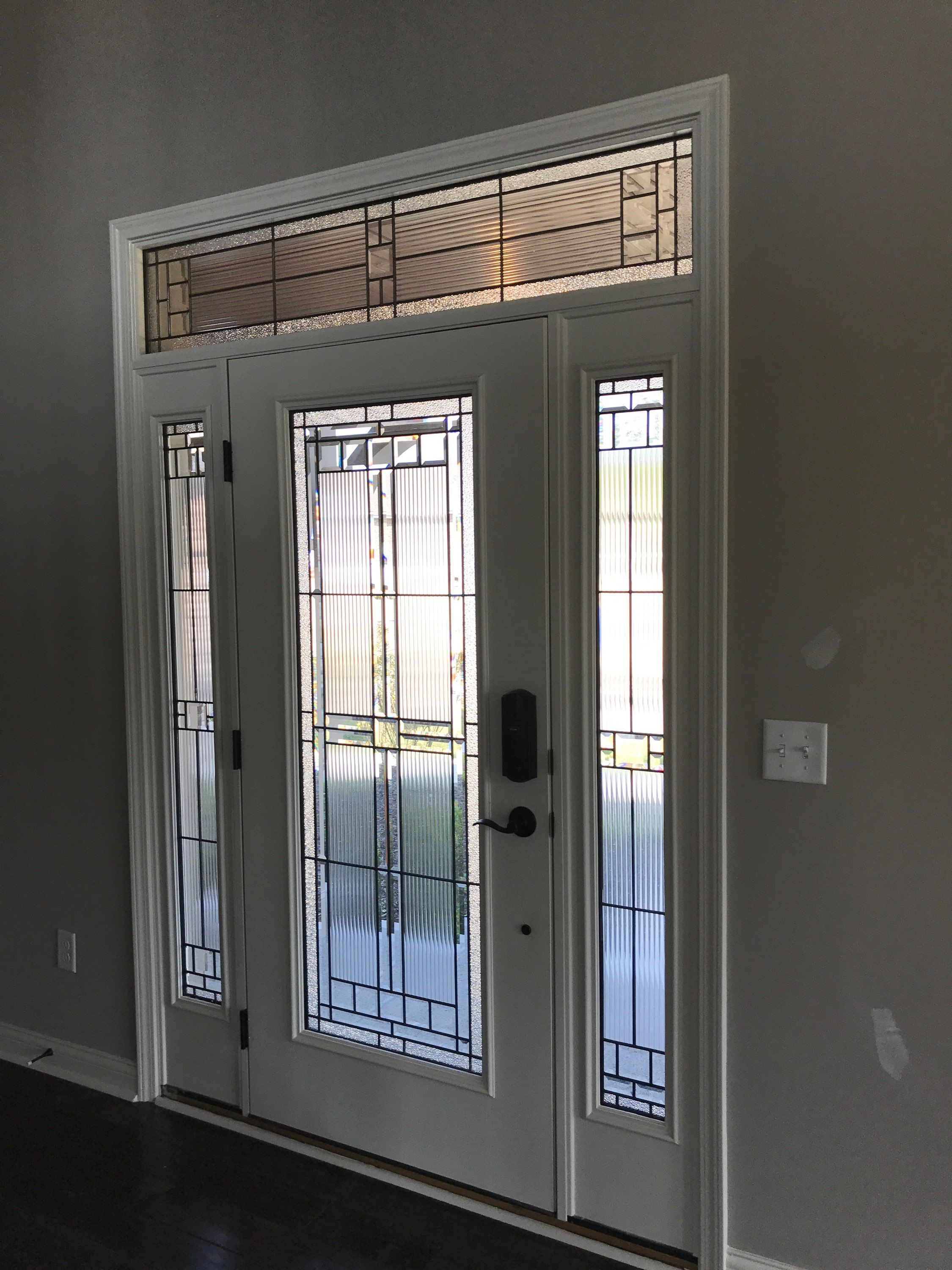 INTERIOR VIEW OF SARATOGA UPGRADED FRONT DOOR, SIDELITES, AND TRANSOM