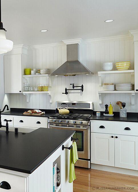 White Kitchen With Black Leathered Granite Countertop Black