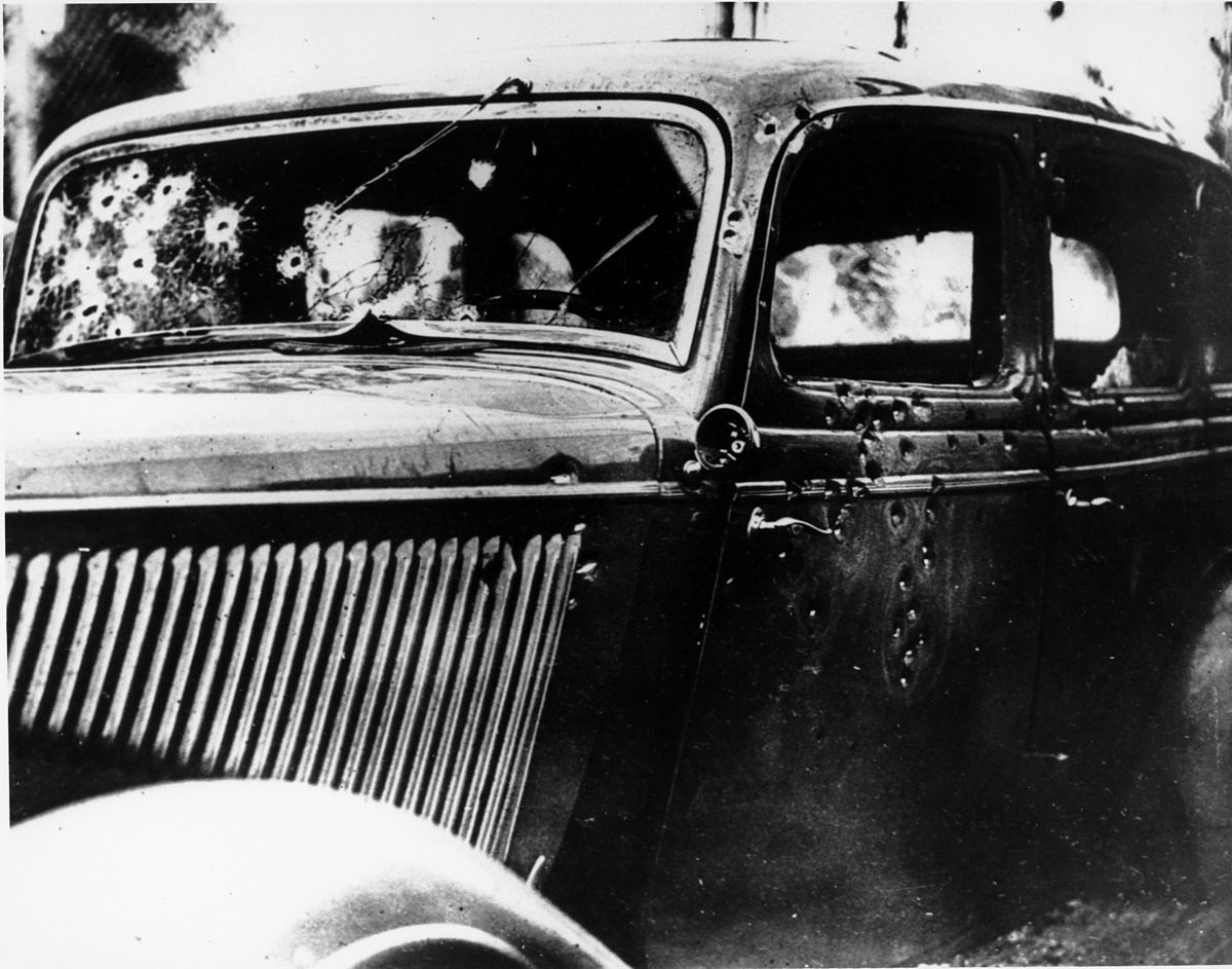 Ap the bullet riddled automobile in which the bandits clyde barrow and bonnie parker were trapped shot and killed on a louisiana road is seen may near