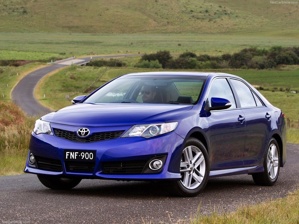 Test drive toyota camry 2012 blue car on the road