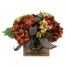 "Silk hydrangea arrangement in a burlap-covered pot with a checkered ribbon.  Product: Faux floral arrangementConstruction Material: Silk, plastic, glass, cotton and burlapColor: Rust, creme, green, black and tanFeatures:Suitable for indoor use only Includes faux hydrangeasli>Dimensions: 9"" H x 13"" W x 13"" D"