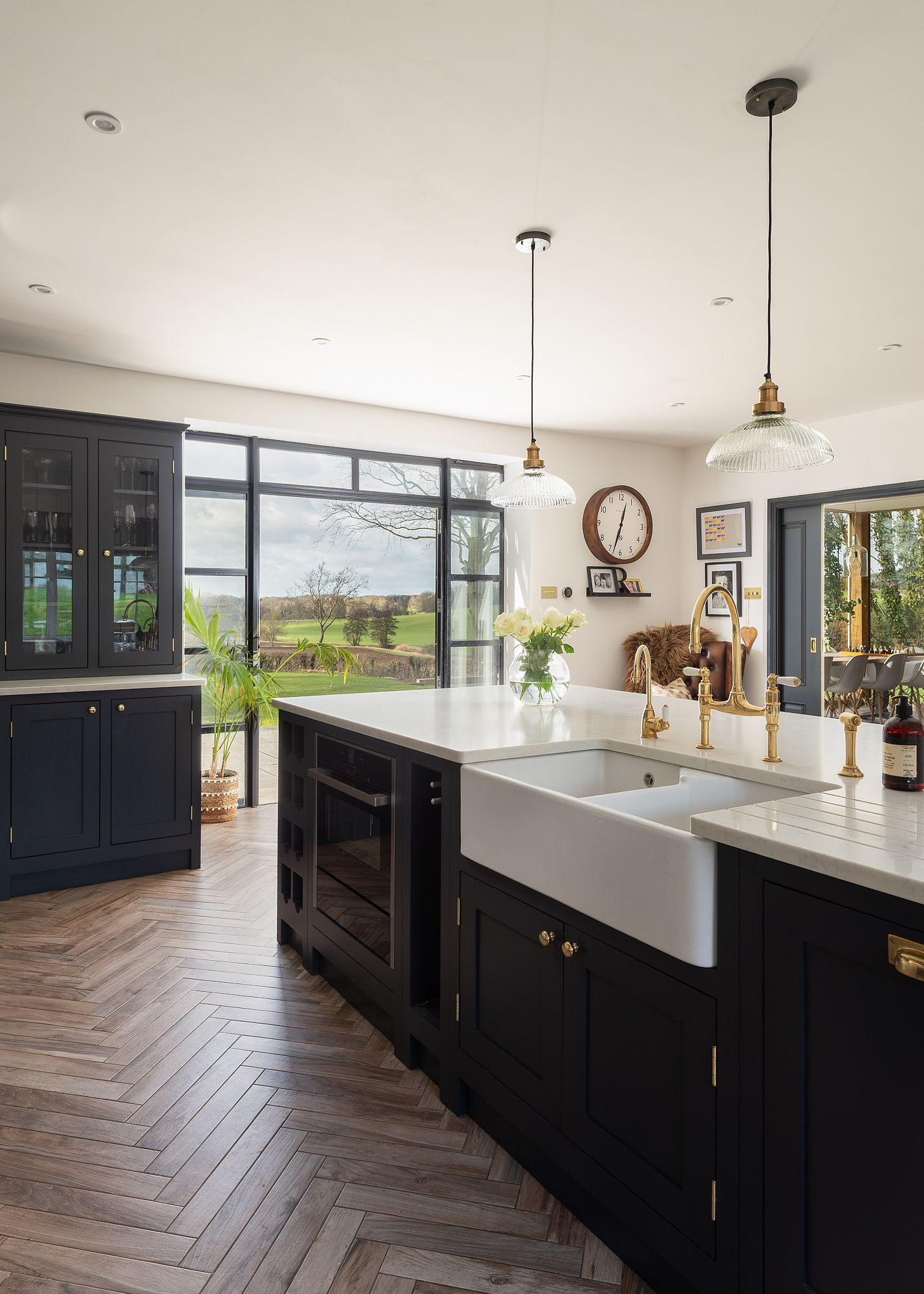 this large kitchen island is multifunctional and houses