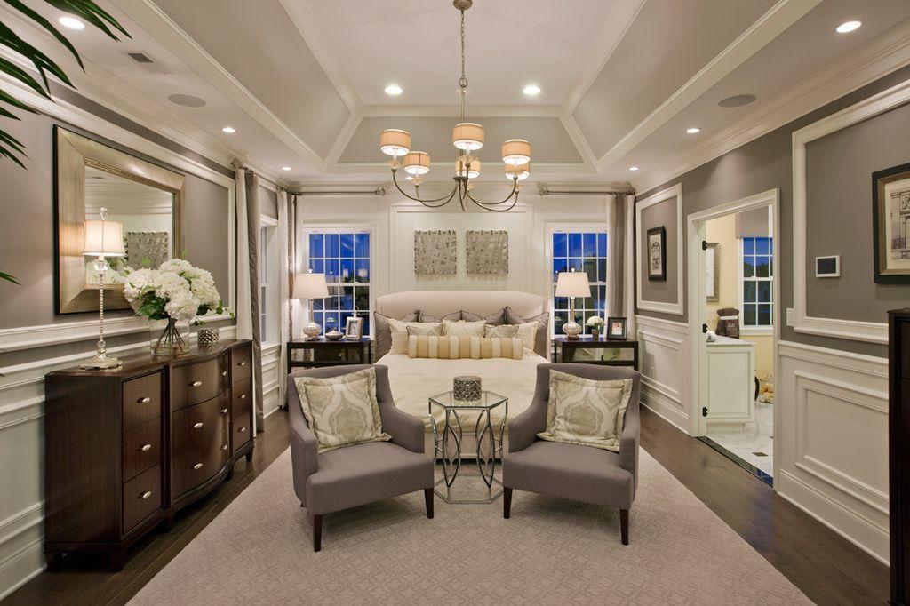 transitional master bedroom windows transitional master bedroom with high ceiling carpet hardwood floors wainscoting crown molding chandelier
