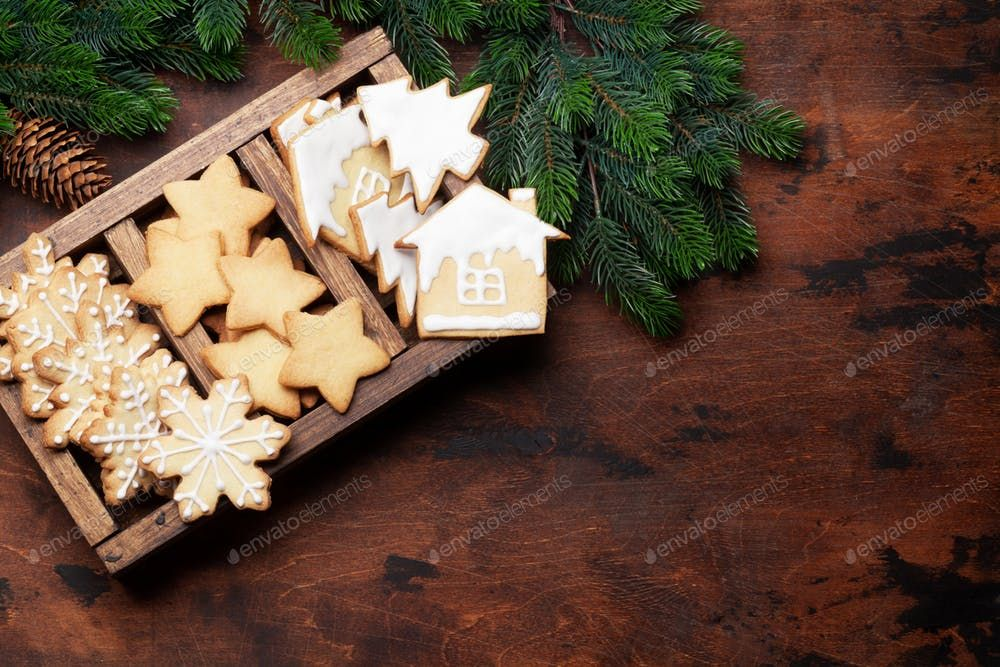 Christmas greeting card with gingerbread cookies By karandaevs photos