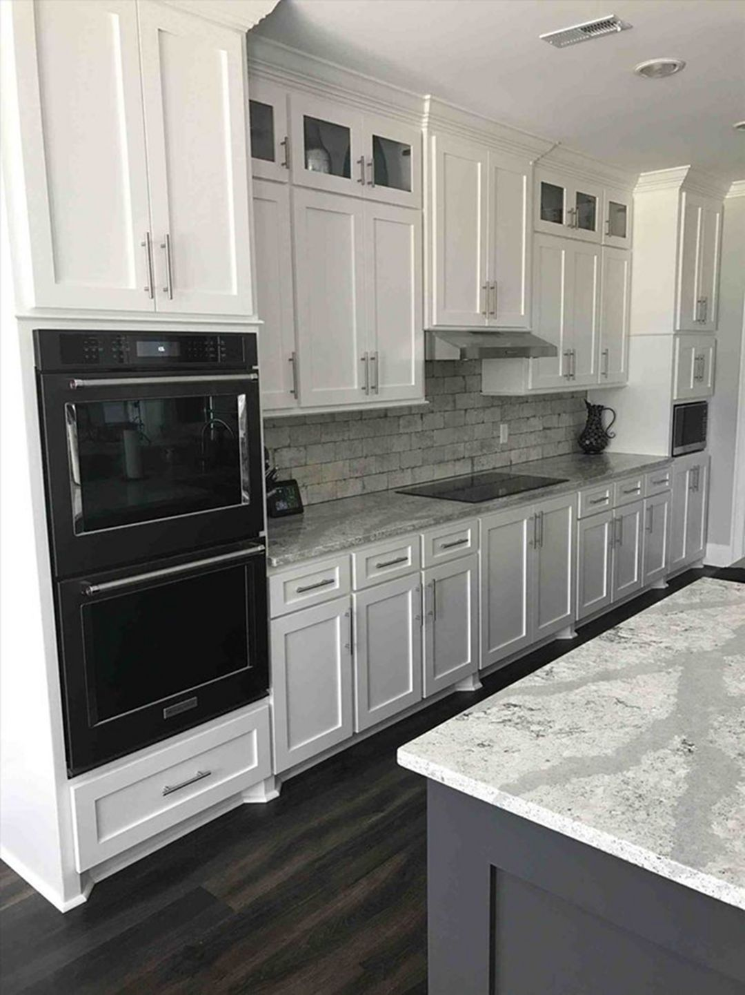 30 Elegant Black And White Kitchen Cabinet And Appliance Ideas Dexorate White Modern Kitchen White Kitchen Design New Kitchen Cabinets Kitchen design with stainless steel appliances