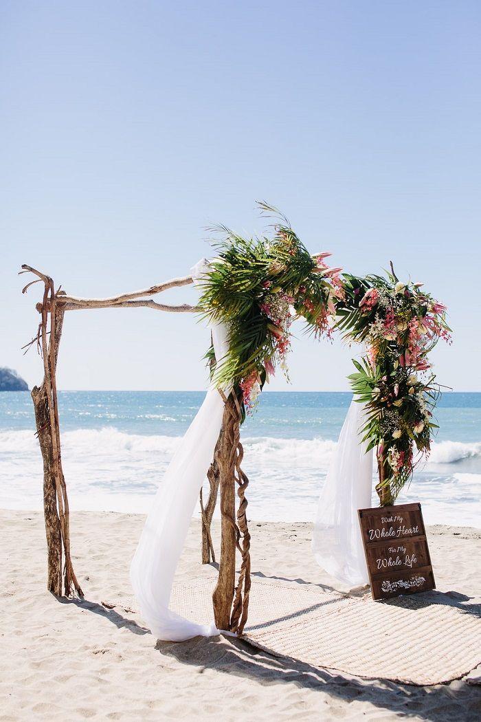 A Lace Olvi Wedding Dress For A Beach Wedding Reception On The