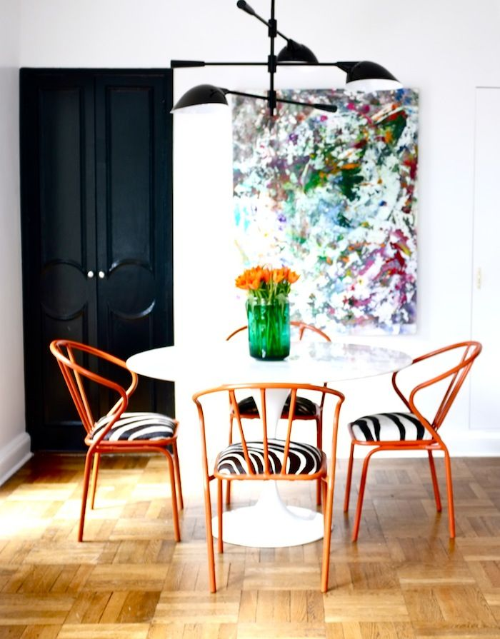 I love it when every element of a room is pure perfection. Chairs, art, light fixture, table .. even the door!