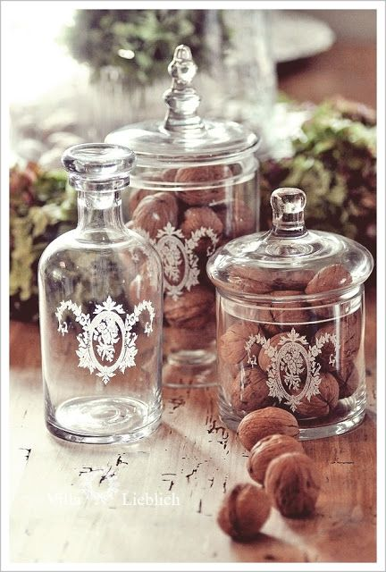 Glass jars of various sizes would be lovely at Thanksgiving and Christmas in our house with its neutral color scheme---with walnuts in one, pecans in one, Brazil nuts...hazelnuts....like this idea---sit them on a tray on the coffee table with nutcrackers!!!