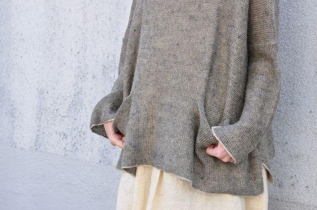 daniela gregis via accoustics.  This looks like the Kaari Sweater here:  http://www.ravelry.com/projects/garmenthouse/kaari