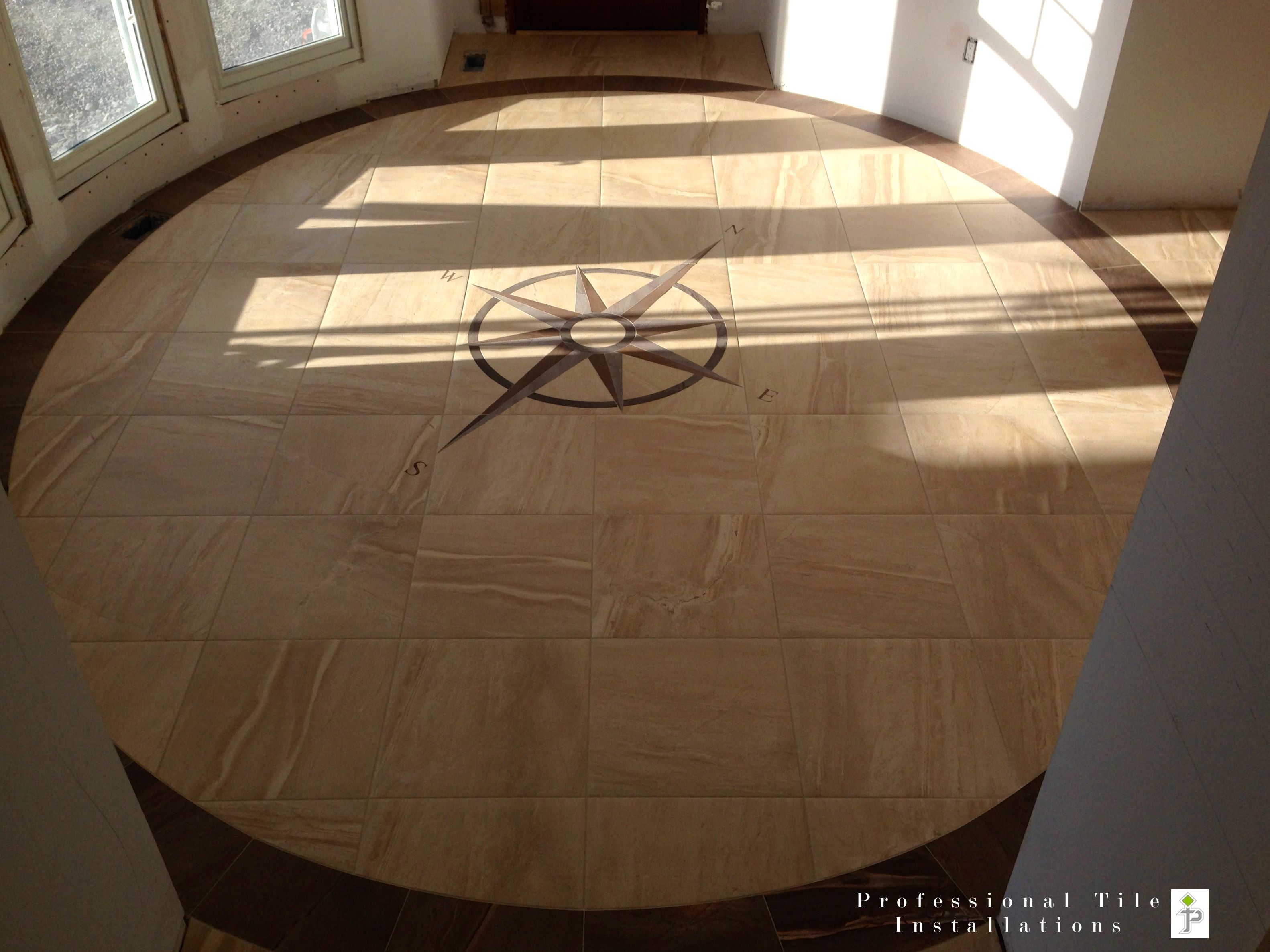 Porcelain tile inlay of a true north facing nautical compass porcelain tile inlay of a true north facing nautical compass elliptical front entrance dailygadgetfo Images