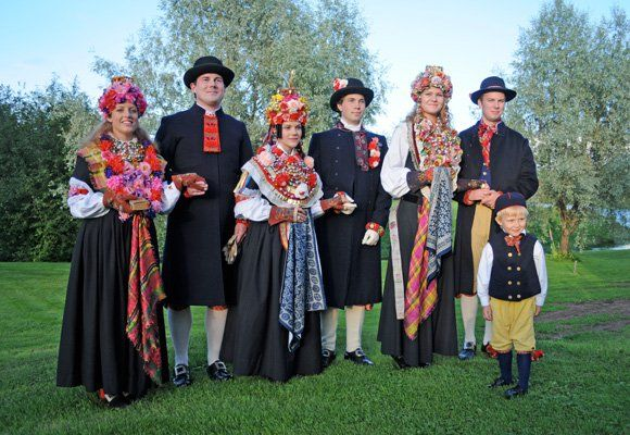 Swedish traditional wedding party with bride and groom. May be a