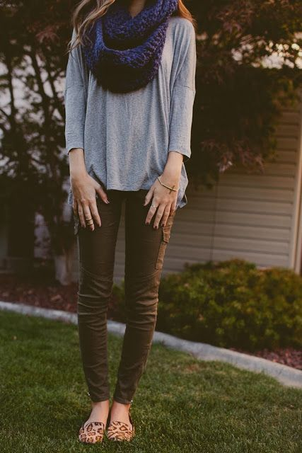 Gray shirt, olive pants, blue scarf