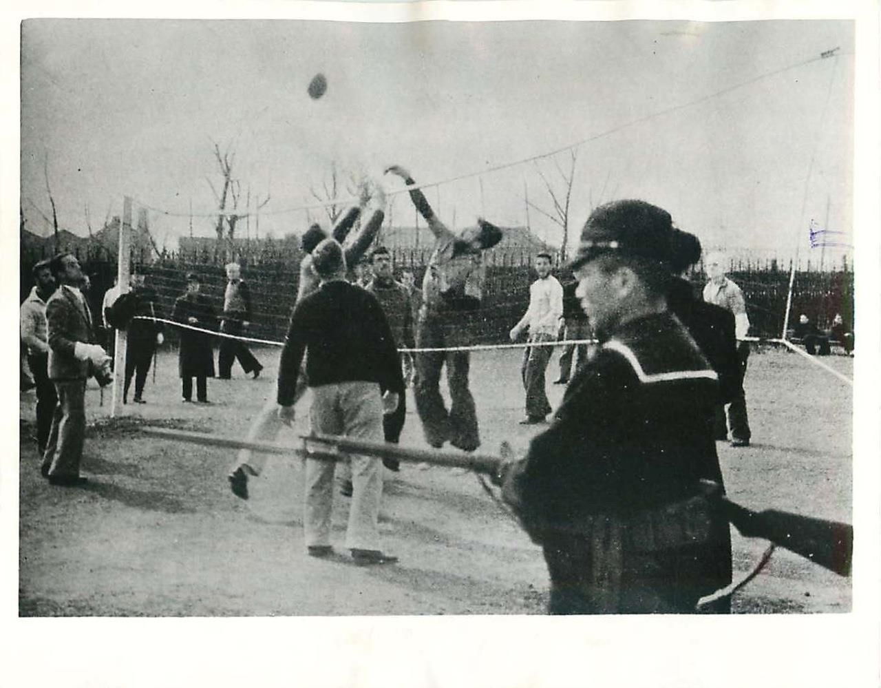 "1942- Photo from propaganda magazine ""Freedom"", published by the Japanese at Shanghai, shows U.S. soldiers playing volleyball at a prison camp ""somewhere"" in Shanghai."