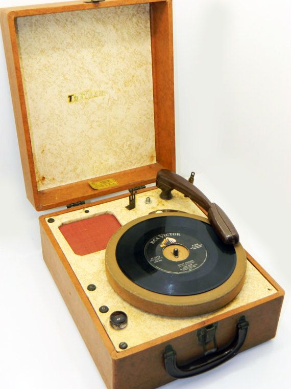 Vintage Traveler portable working record player. $73.65, via Etsy.