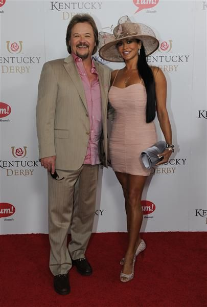 Travis Tritt and his wife, Theresa, attend the 140th Kentucky Derby at Churchill Downs in Louisville, Ky., on May 3, 2014.