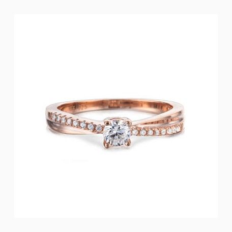 Rose gold ring with sparkling diamond like stones