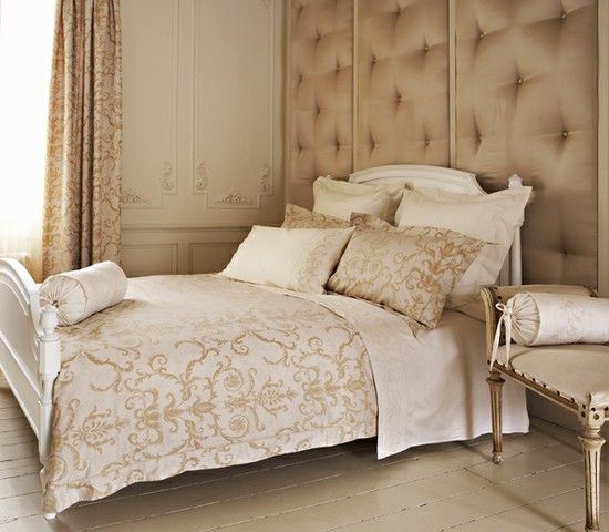 Majestic Gold And Cream Bedroom With Upholstered Wall