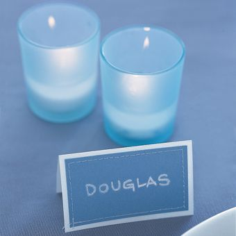 Something Blue: Matching place cards, with stylish stitching, from Unique Artistry, uniqueartistry.com. Votives, from Jamali, jamaligarden.com.