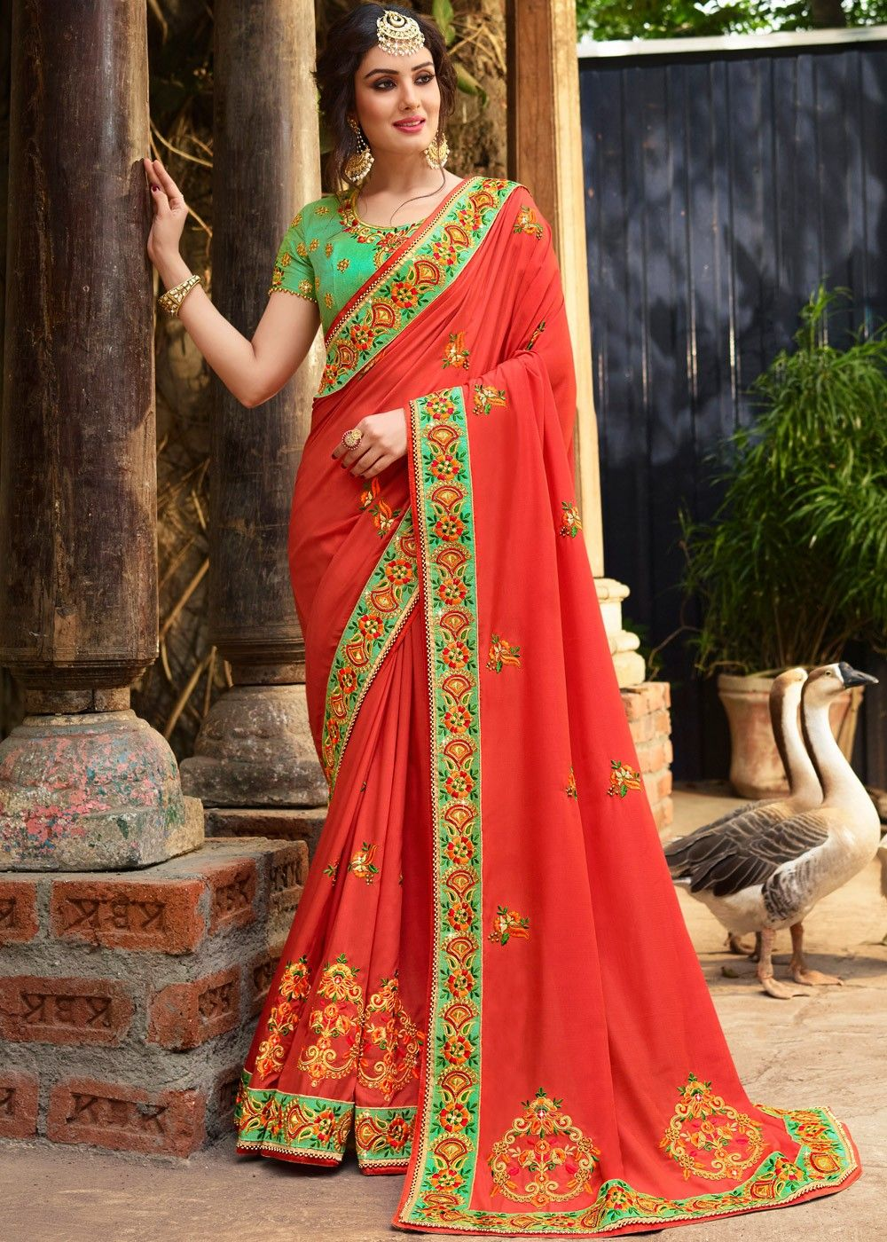 f2753747f7 Light #red crape #saree with border work and motifs in #zari work, #resham  #embroidery, stones & beaded details.