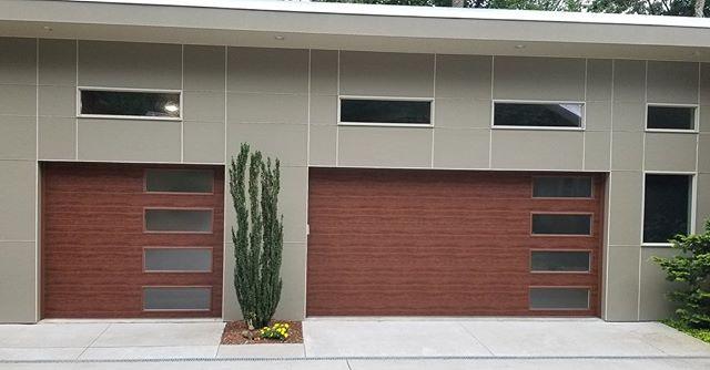 Modern Steel Garage Doors With Vertical Stack Windows In Frosted Glass And Grooved Panel Design Clopay Gara In 2020 Solid Wood Doors Steel Garage Doors Garage Doors