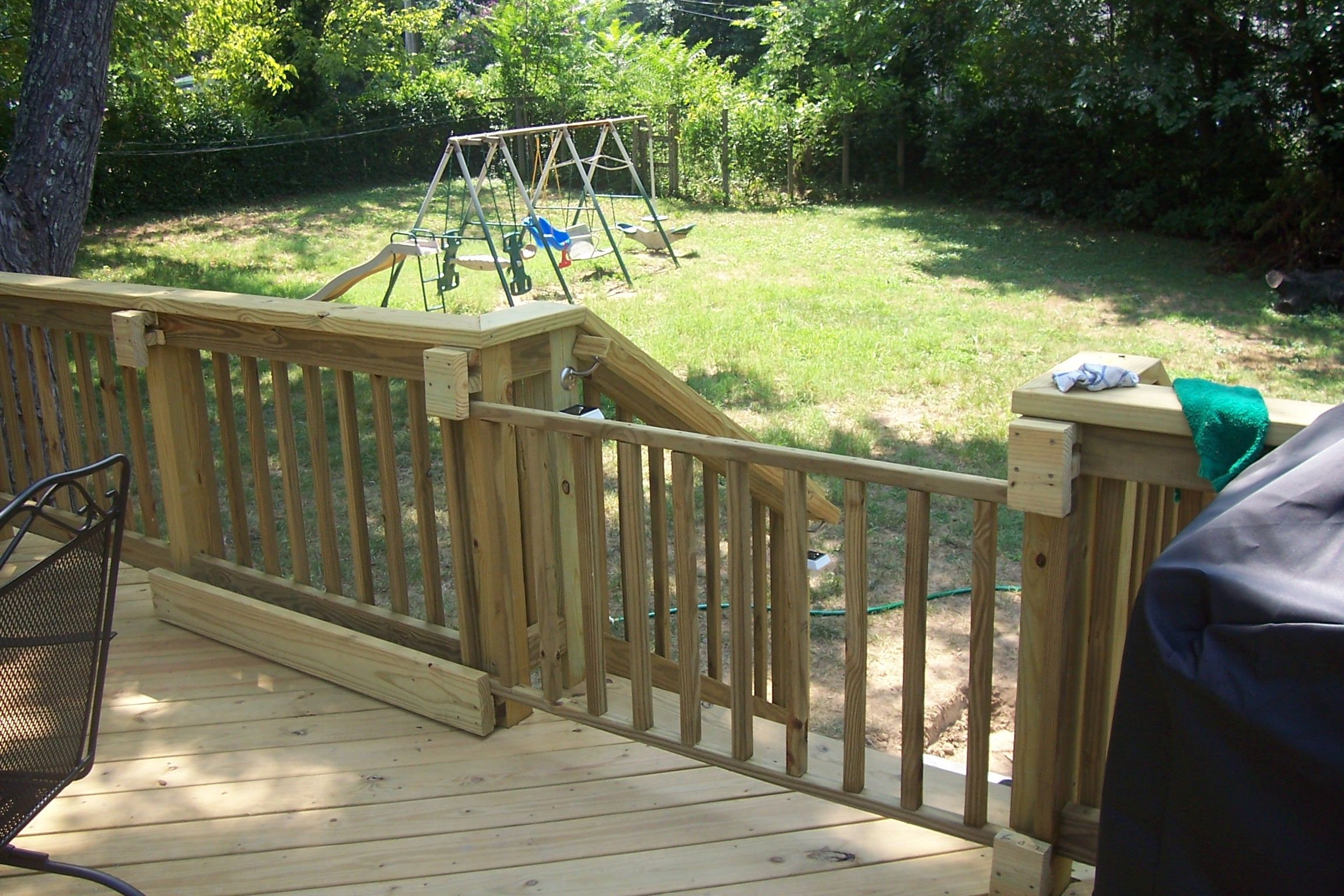 Use metal slider hardware wood at bottom keeps gate