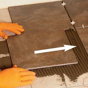 Tile Installation: How to Tile Over Existing Tile | Tiled fireplace ...