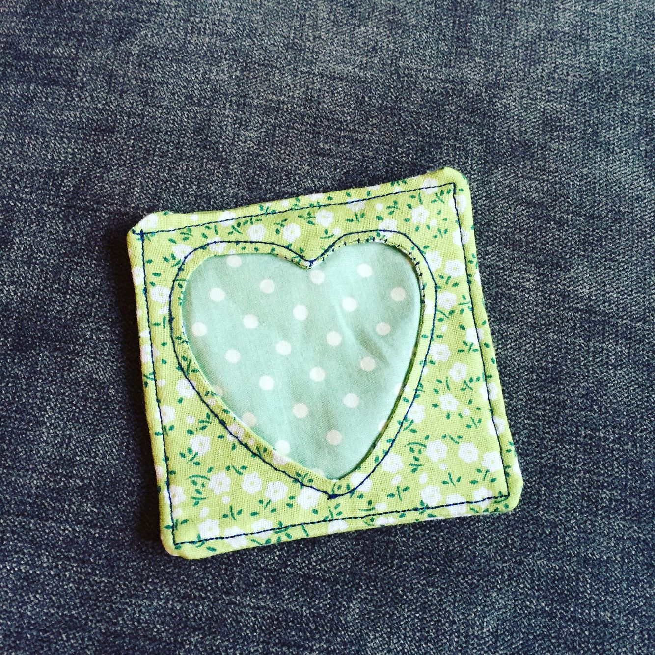 Cute little coaster made of some scrap pieces of fabric I had spare :)
