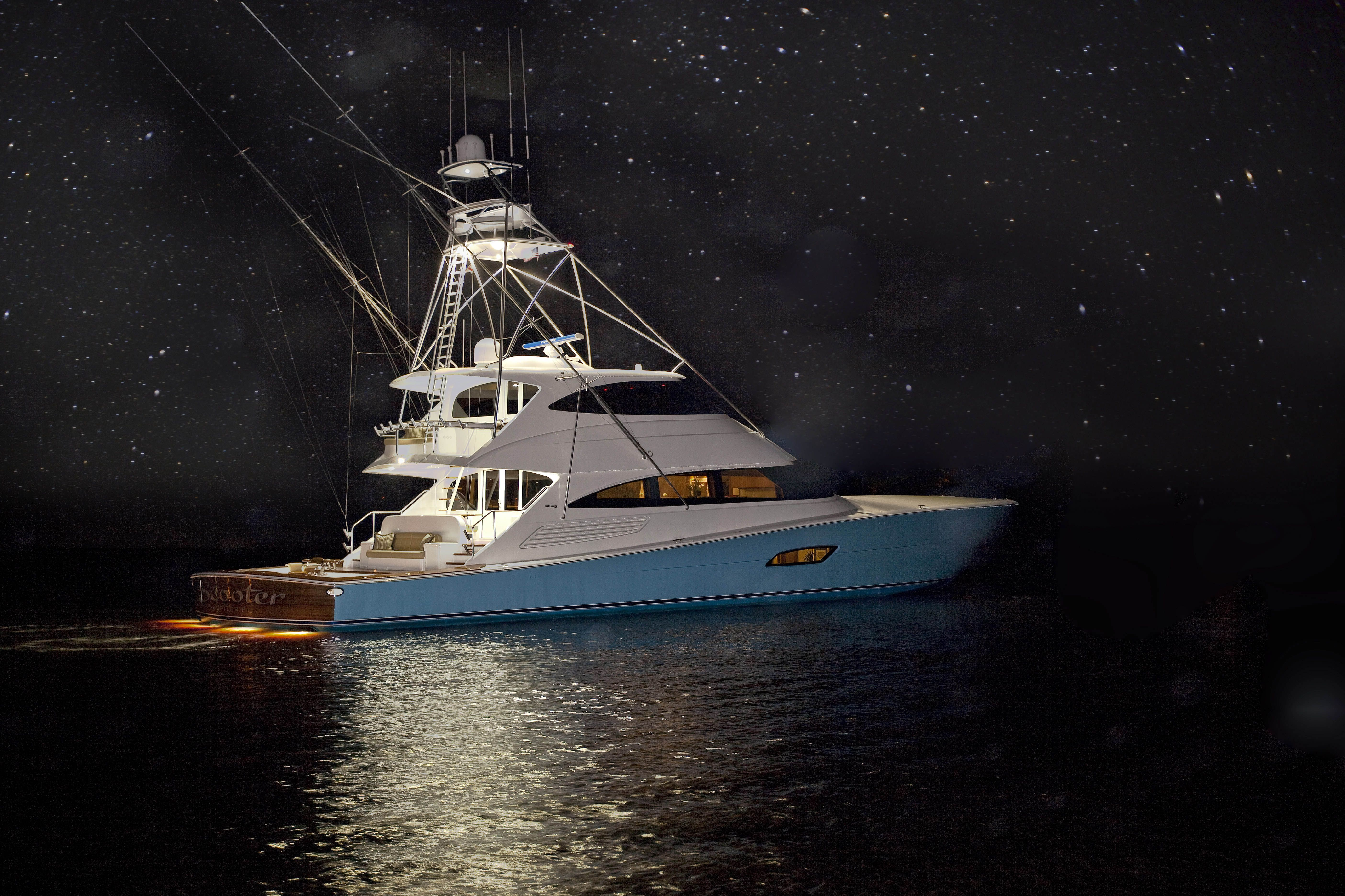 Scooter is a 2014 Viking Yachts 92 Enclosed Bridge for