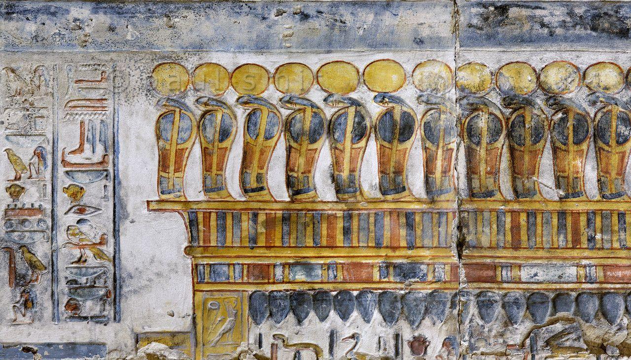 Egypt uuraeuses decorating a shrine at abydosu egypt and