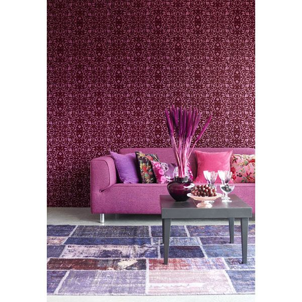 Magenta pink and purple living room decor idea with a plush flock ...