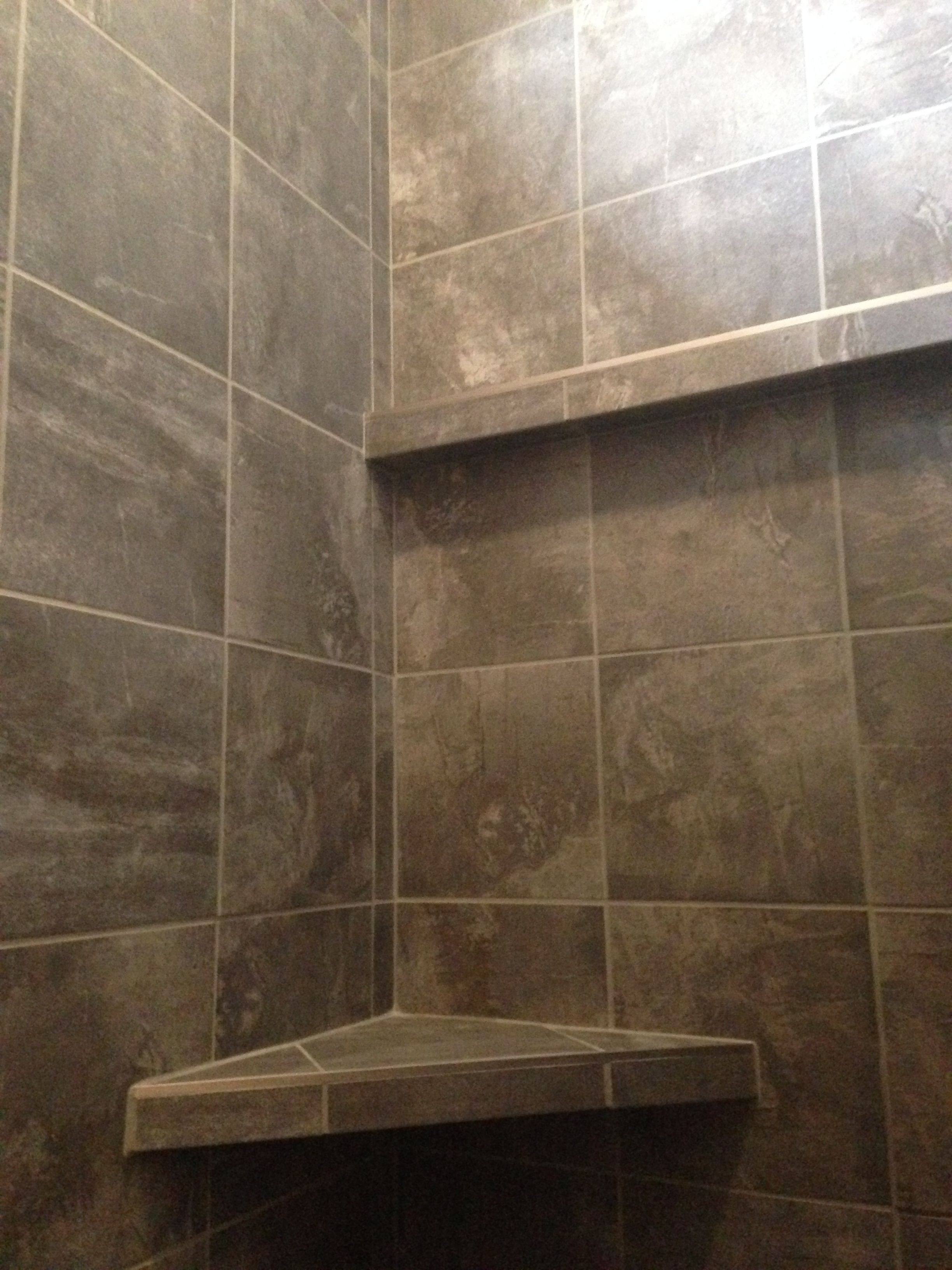 custom tiled shower in a porcelain slate looking tile with a built in bench and shelf design. Black Bedroom Furniture Sets. Home Design Ideas