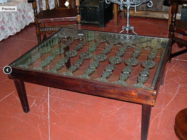 Spanish Style Coffee table. Case iron grill. See: http://www.mediterraniaantiques.com/tables1.html