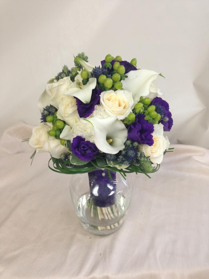 Traditional bridal bouquet with white purple and green flowers. Designed by Rebekah at Ballard Blossom, Seattle Wedding Flowers, Seattle Florist.