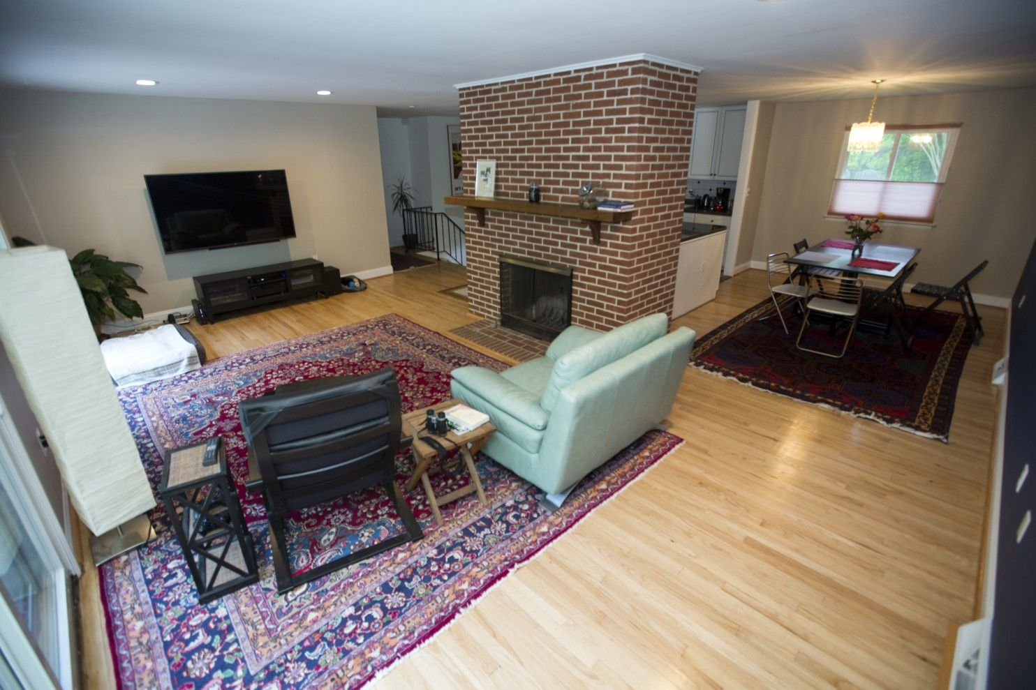 To make an open floor plan more cohesive, start by painting the brick fireplace - The Washington Post