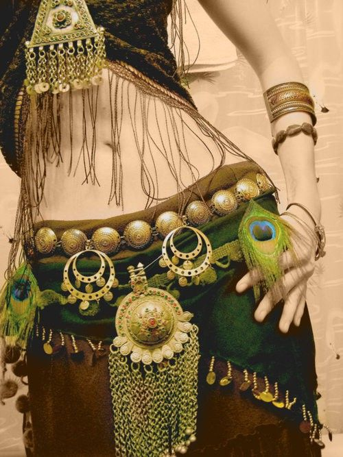 peacock feathers and nomadic silver jewelry  as hip ornaments