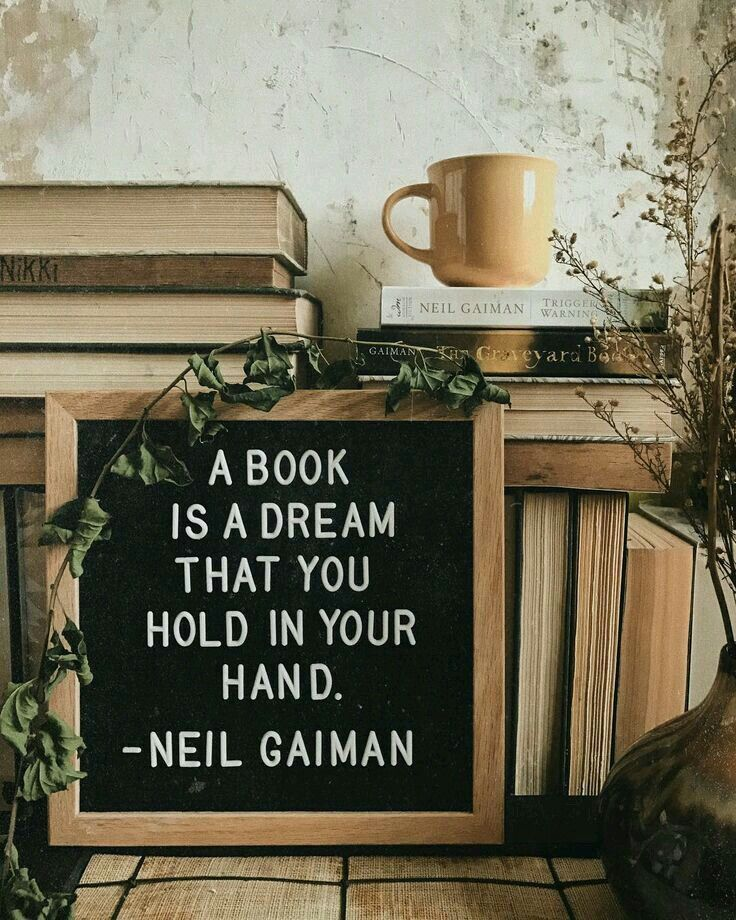 """""""A book is a dream that you hold in your hand."""" --Neil Gaiman"""